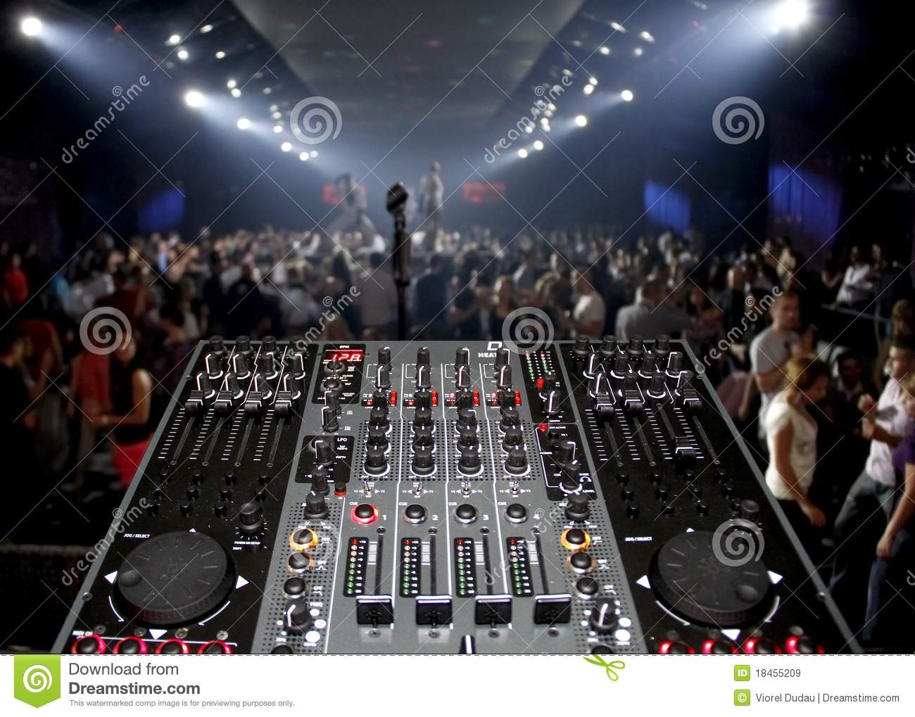 DJ desk in a nightclub party with lightshow