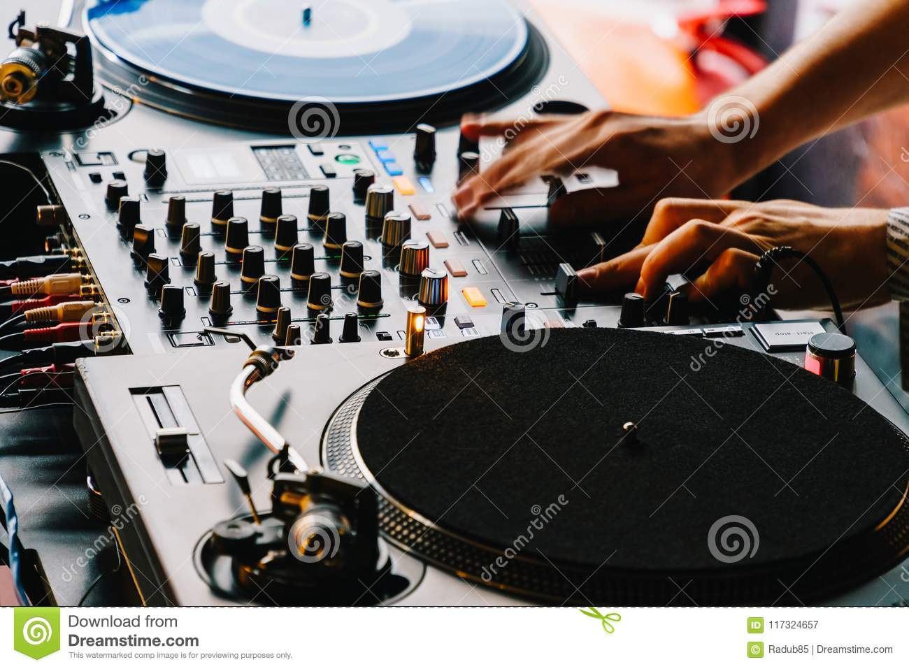DJ Equipment Deck With Music Track Control And Mixer At Club Party