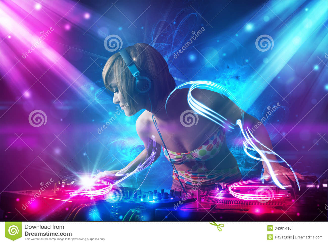 Dj Girl Mixing Music With Powerful Light Effects Stock