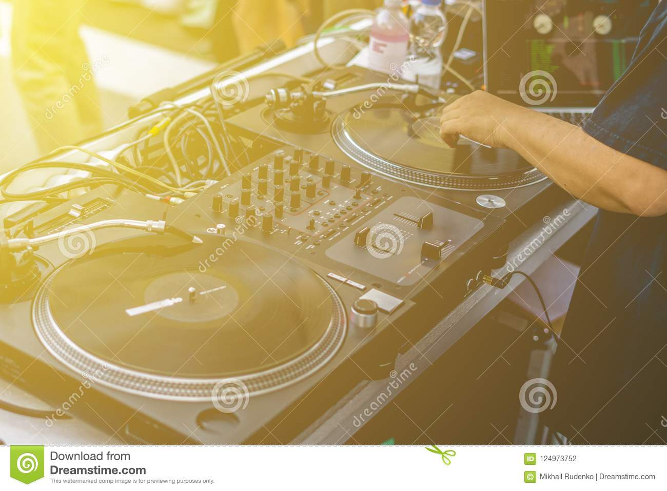 Dj Hands Play Music Vibes On A Summer Beach Party Using A Vintage