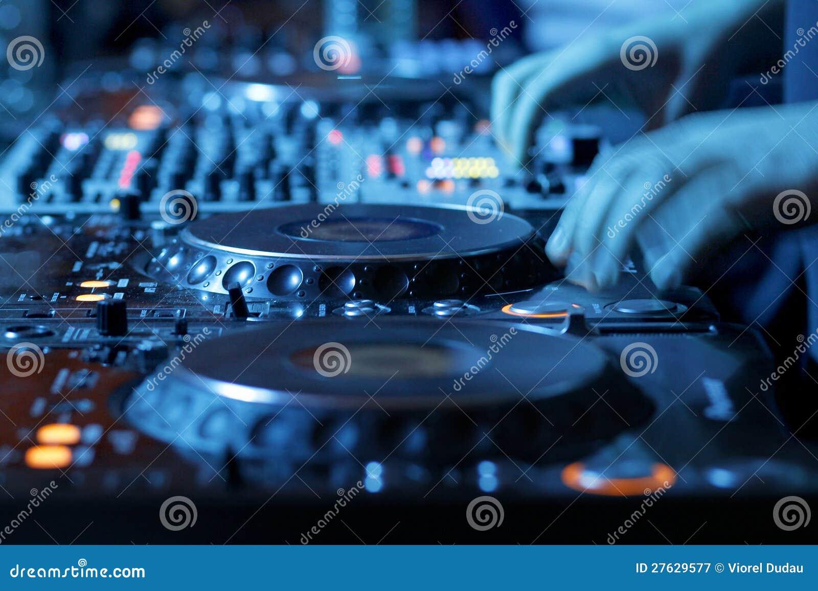 DJ mixing desk in nightclub