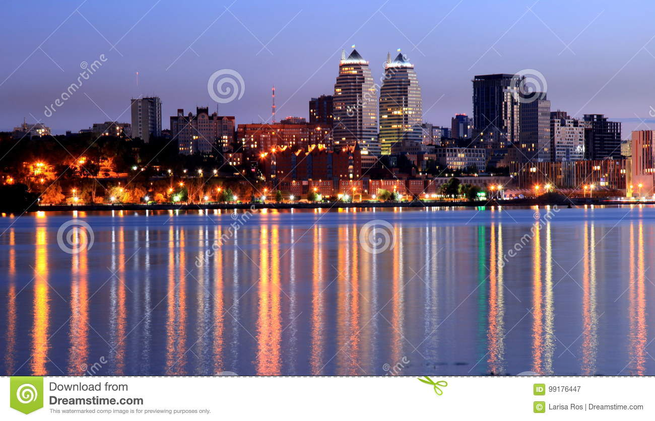 Dnepr city view at night, lights reflected on the river Dnieper, Ukraine