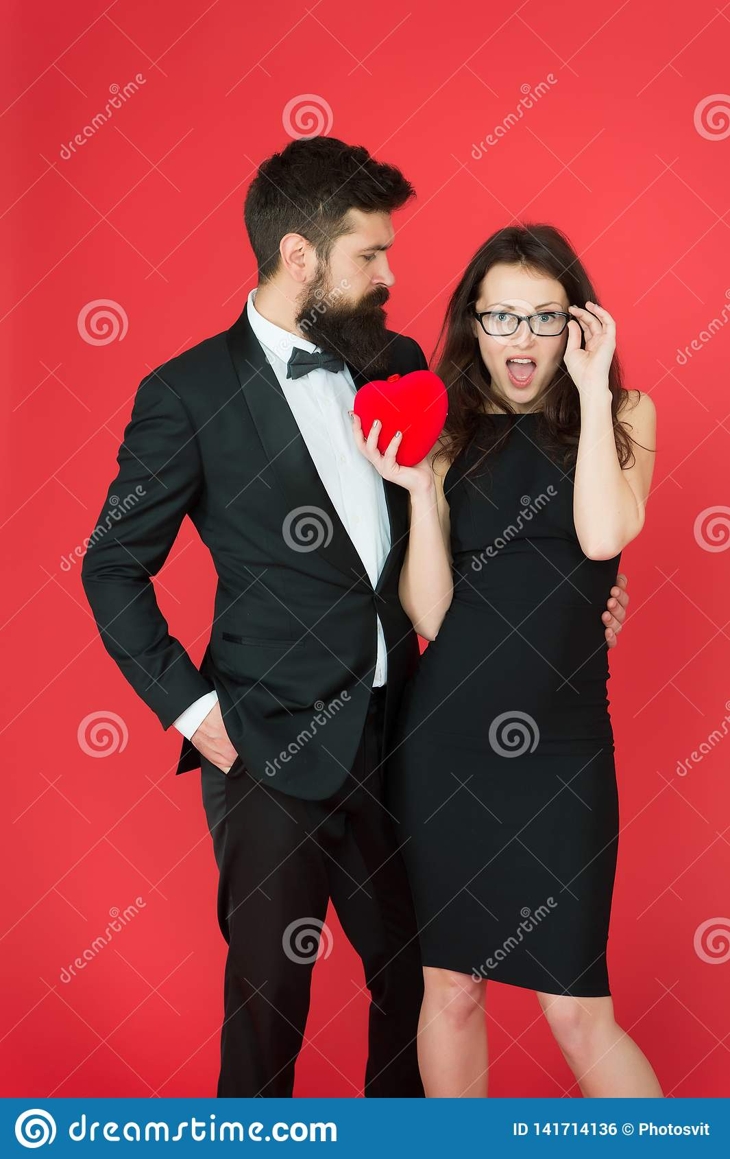 Do not play with my heart. Man with beard and woman happy celebrate anniversary. Couple in love dating anniversary. Man