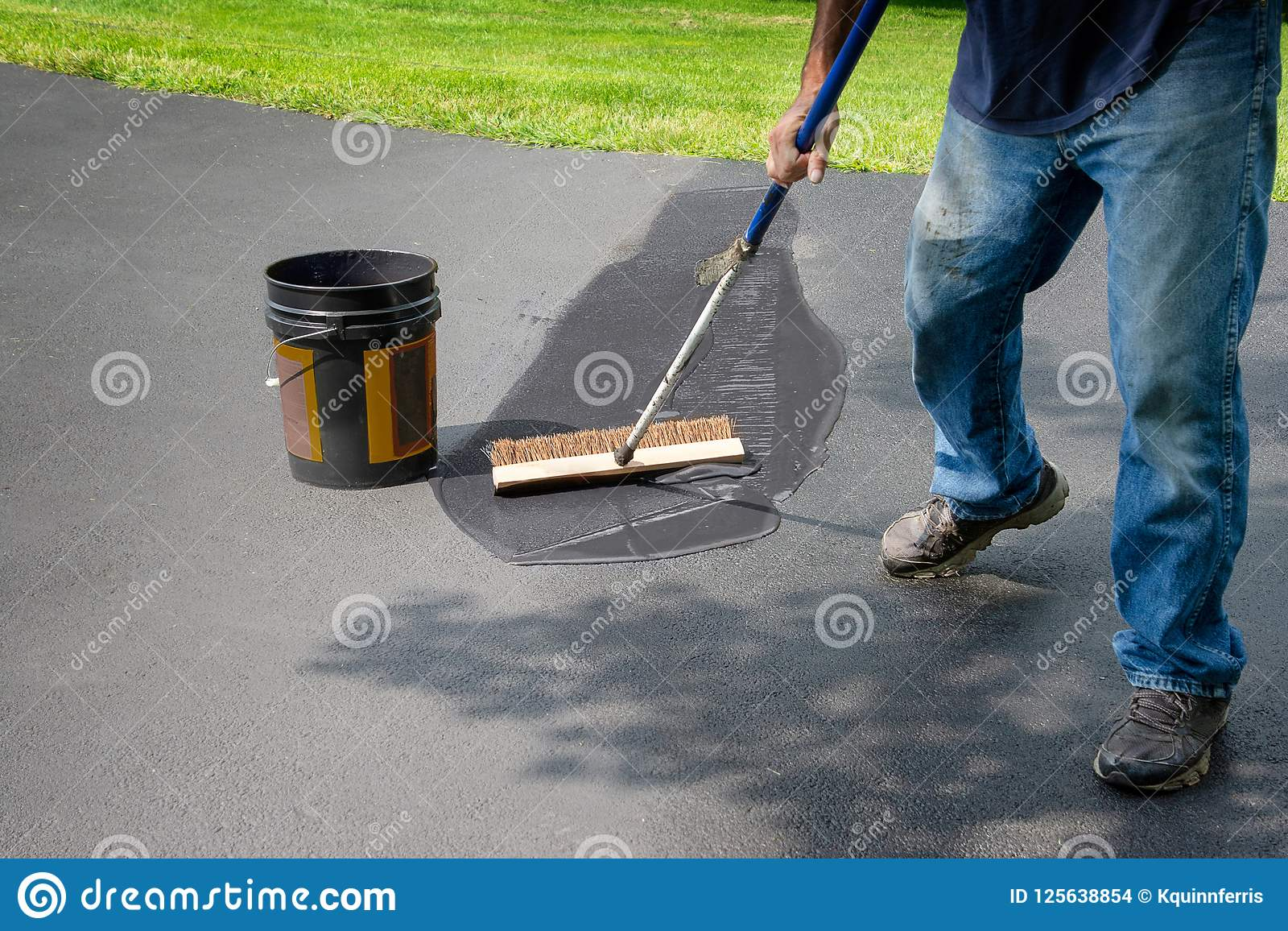 Spreading asphalt in home driveway stock photo image of coating download spreading asphalt in home driveway stock photo image of coating pavement 125638854 solutioingenieria Gallery