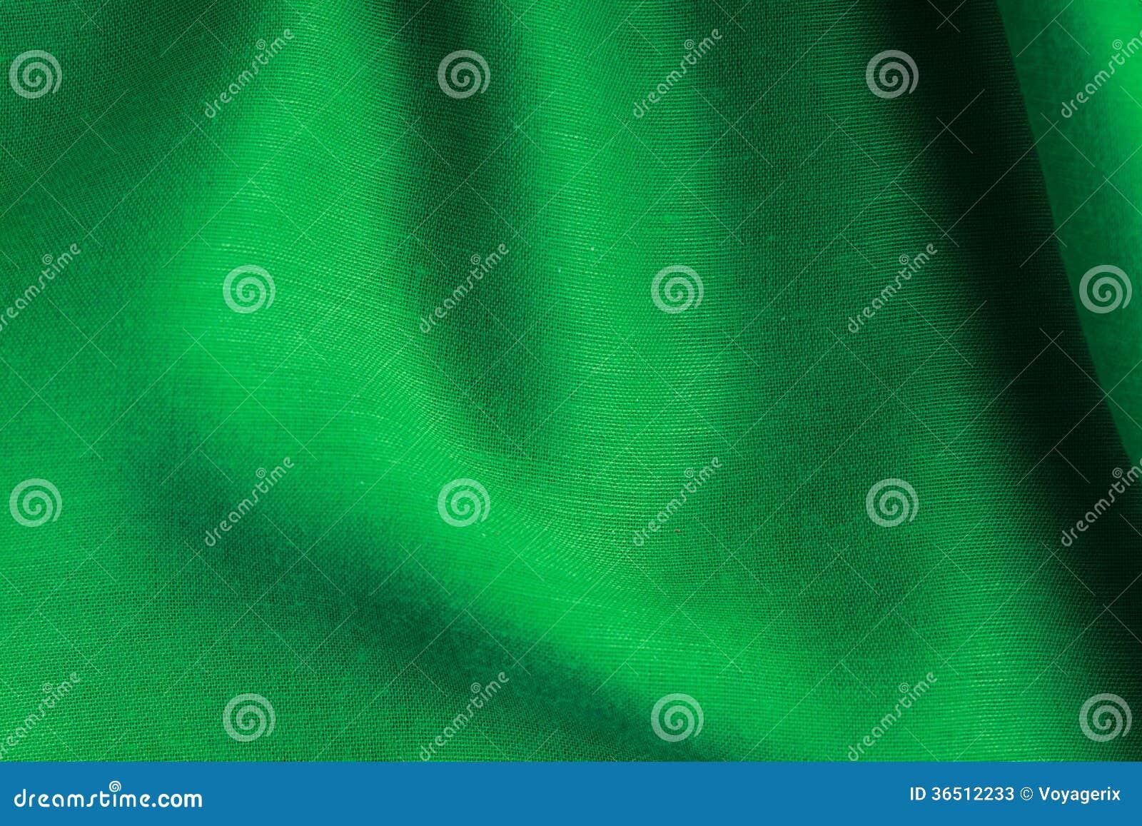Dobras onduladas de pano verde do sumário do fundo da textura de matéria têxtil