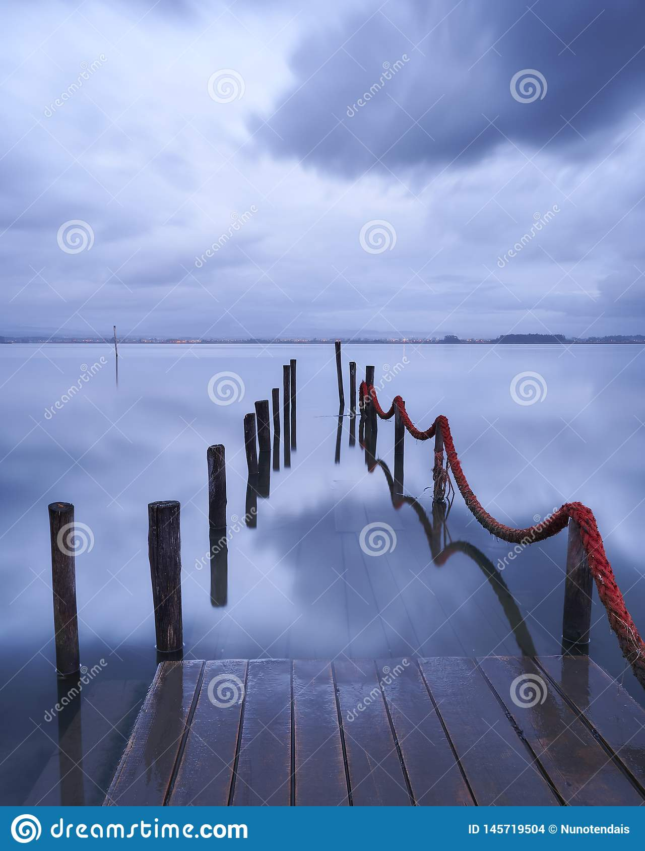 Dock disappear into the lake reflecting waters