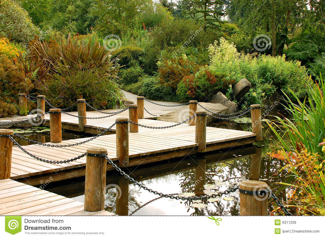 Dock on garden pond stock image image of dock path for Pond pier plans