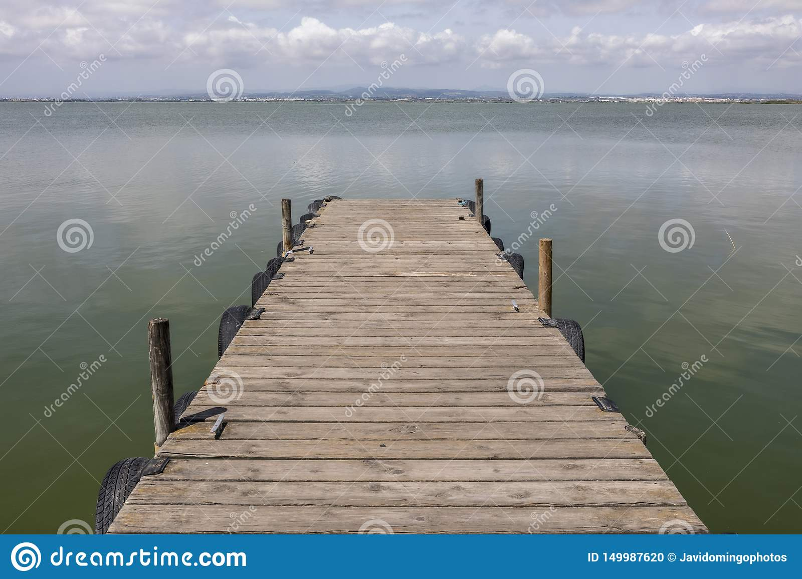 A Dock By The Lake At morning Sky