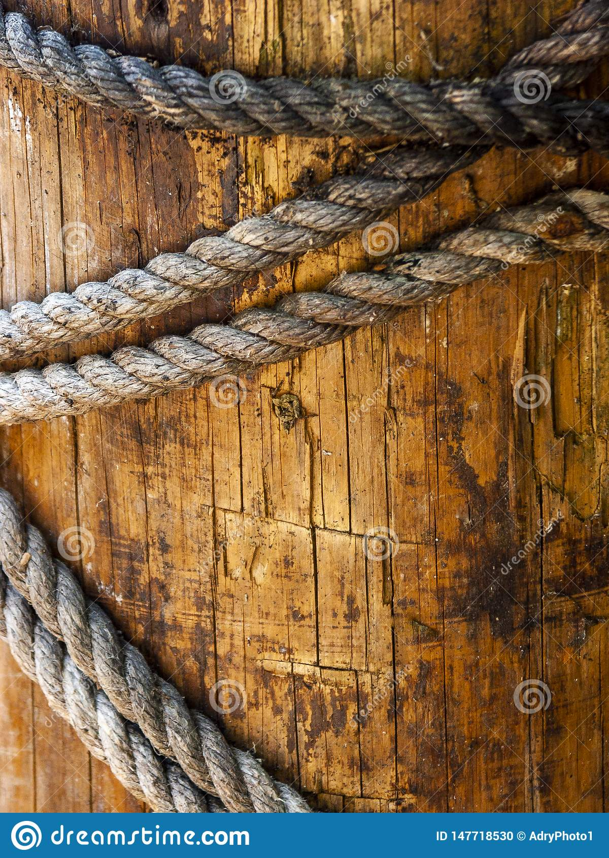 Dock in nautical pier wood with strings worn with time and natural elements