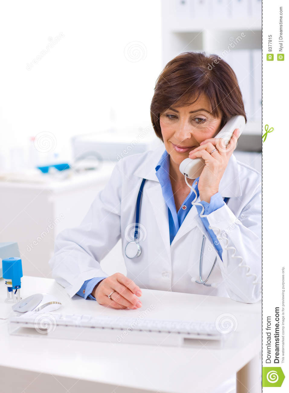 Doctor Calling On Phone Royalty Free Stock Photo - Image: 8377815
