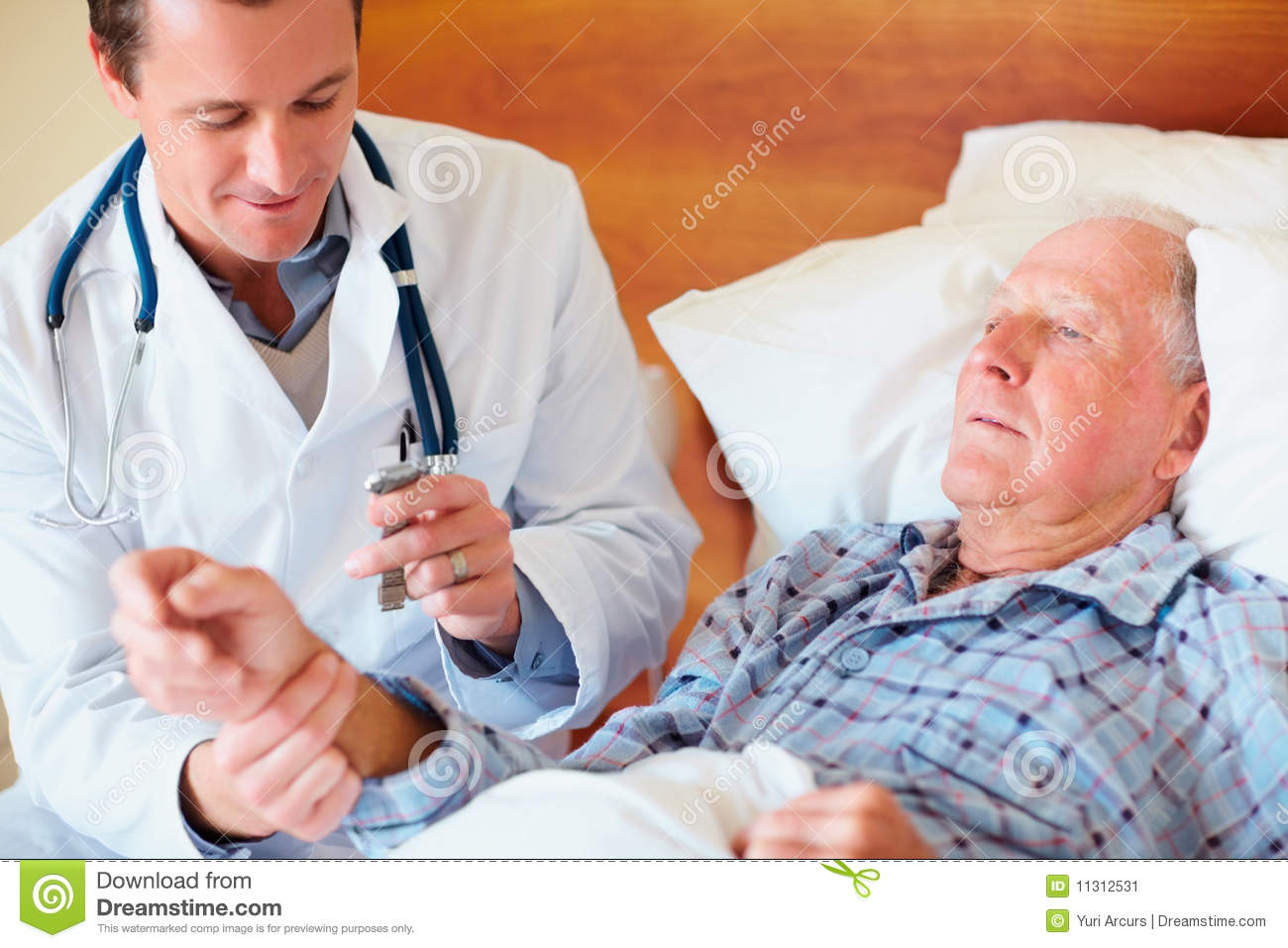 doctor checking the pulse rate of an old patient stock