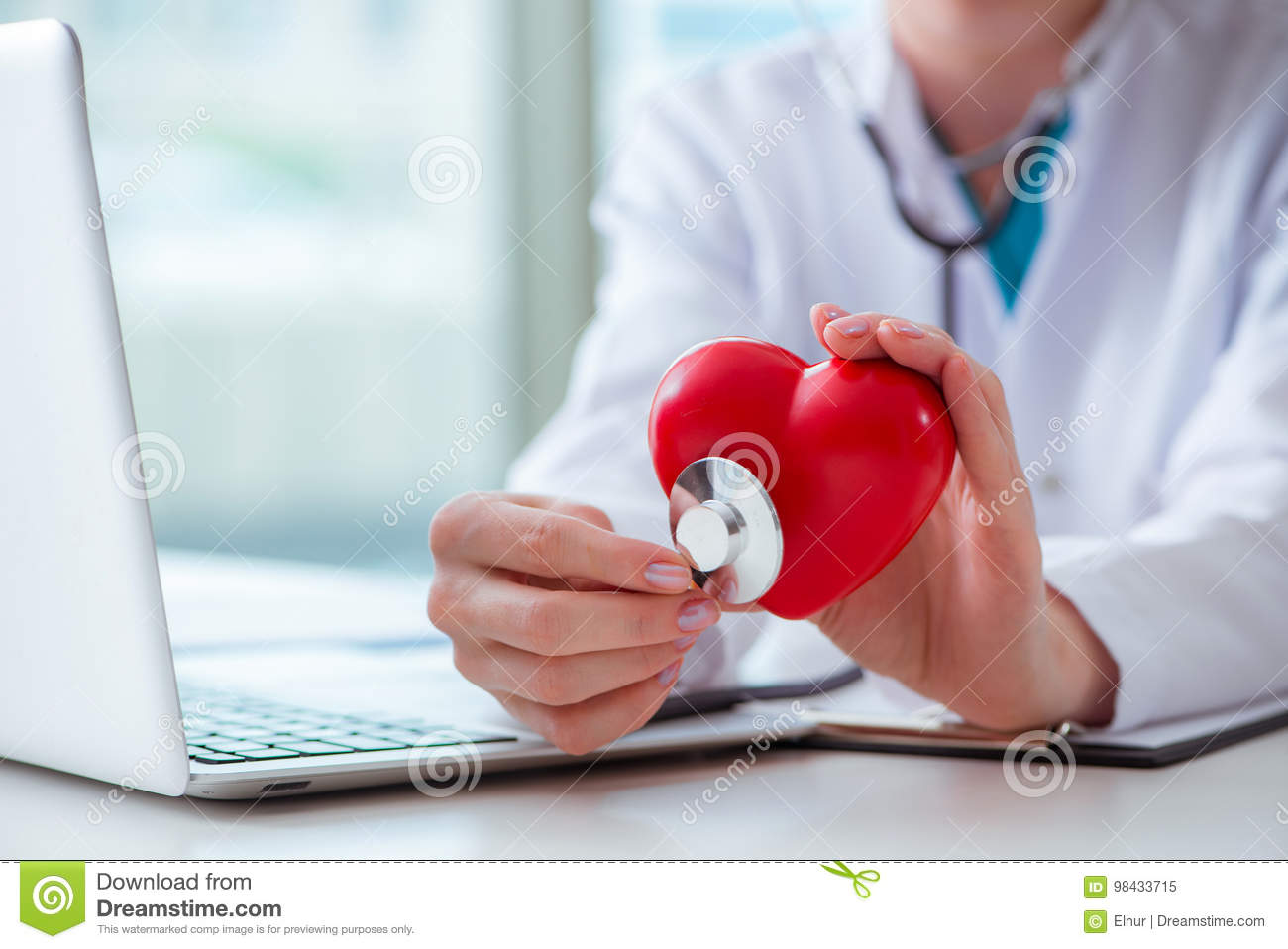 The doctor checking up heart in medical concept