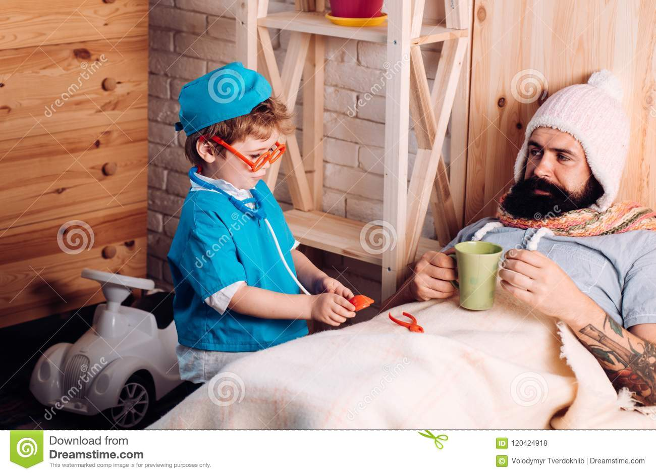 Download Doctor Child In Glasses With Stethoscope Examine Father At Home Doctor Boy In Doctor Uniform Treat Patient, Game And Stock Photo - Image of beard, friendship: 120424918