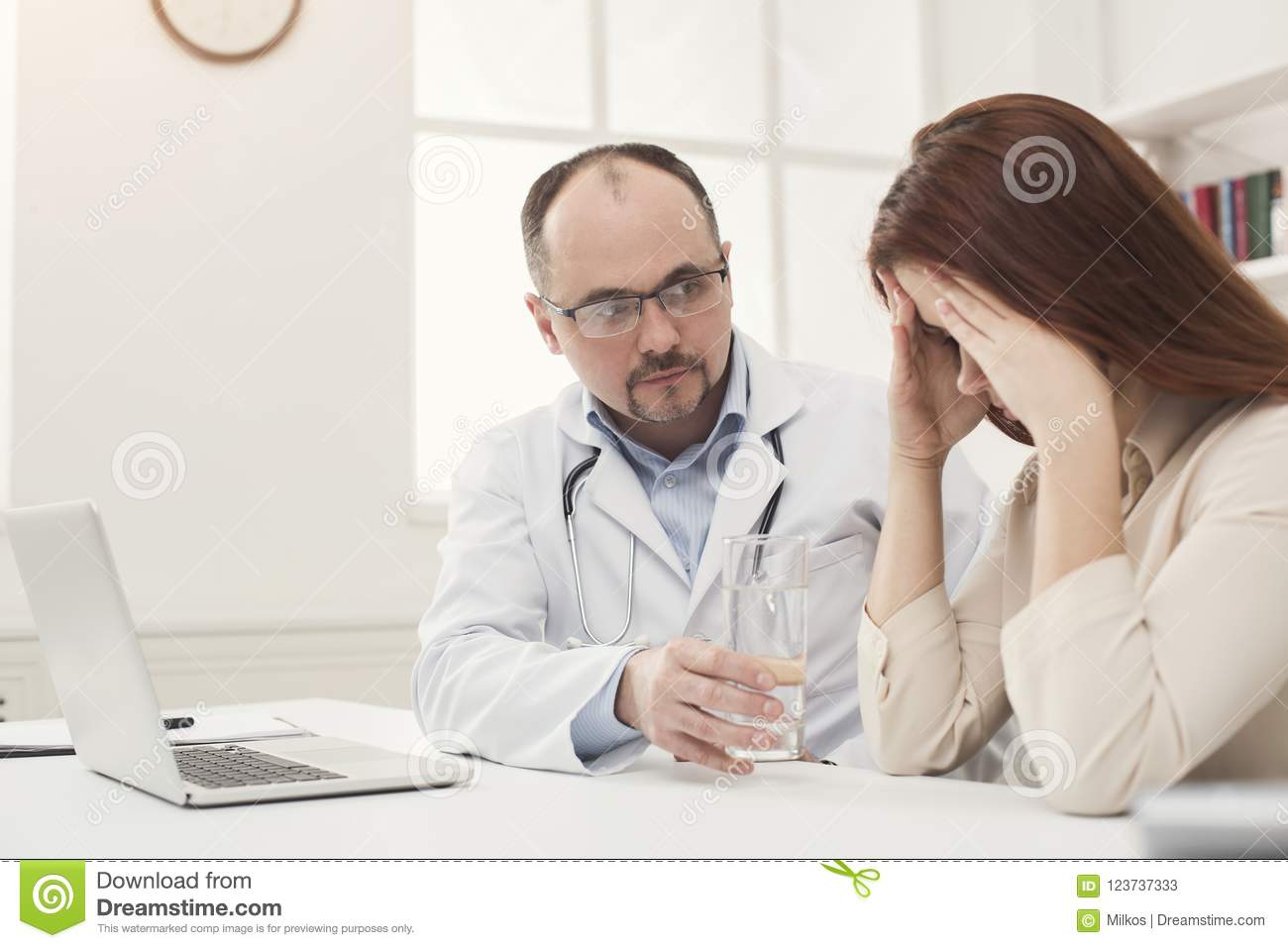 Doctor consulting woman in hospital