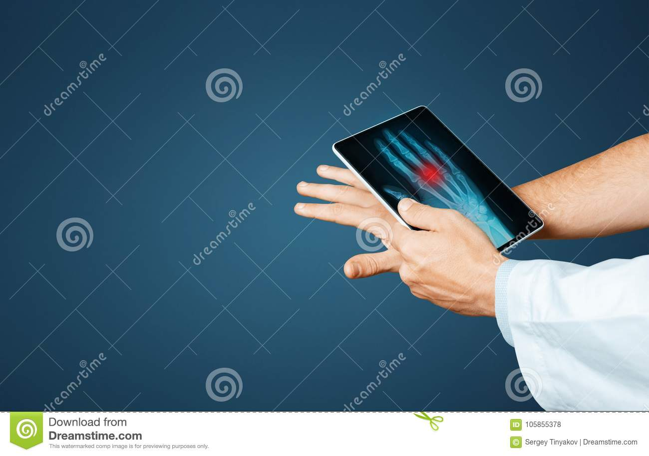 Doctor With Digital Tablet Scans Patient Arm, Modern X-Ray Technologists In Medicine And Healthcare Concept