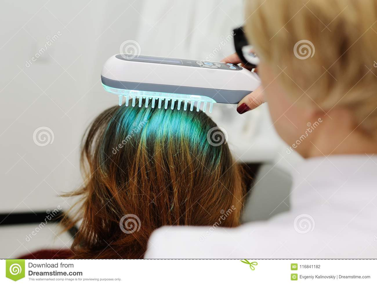 Doctor Examines Scalp A Special Device With A Uv Lamp Stock Photo