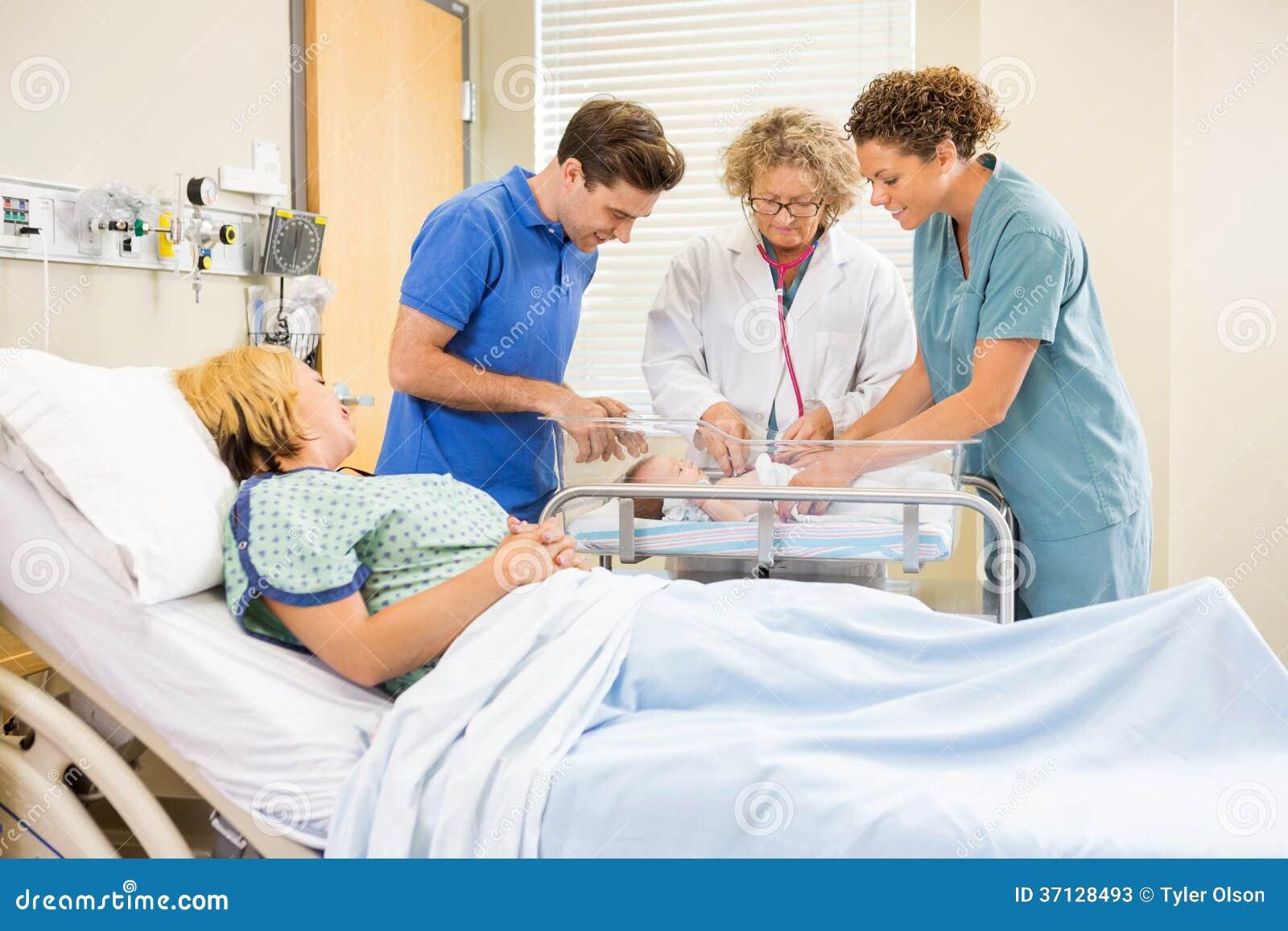 Newborn Babies In Hospital With Nurse