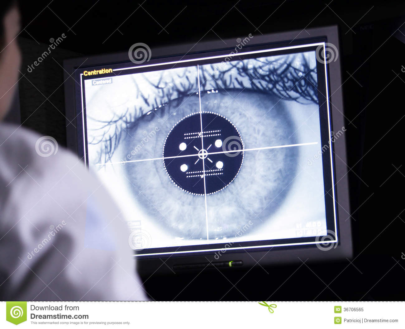 Doctor examining eye scan on computer