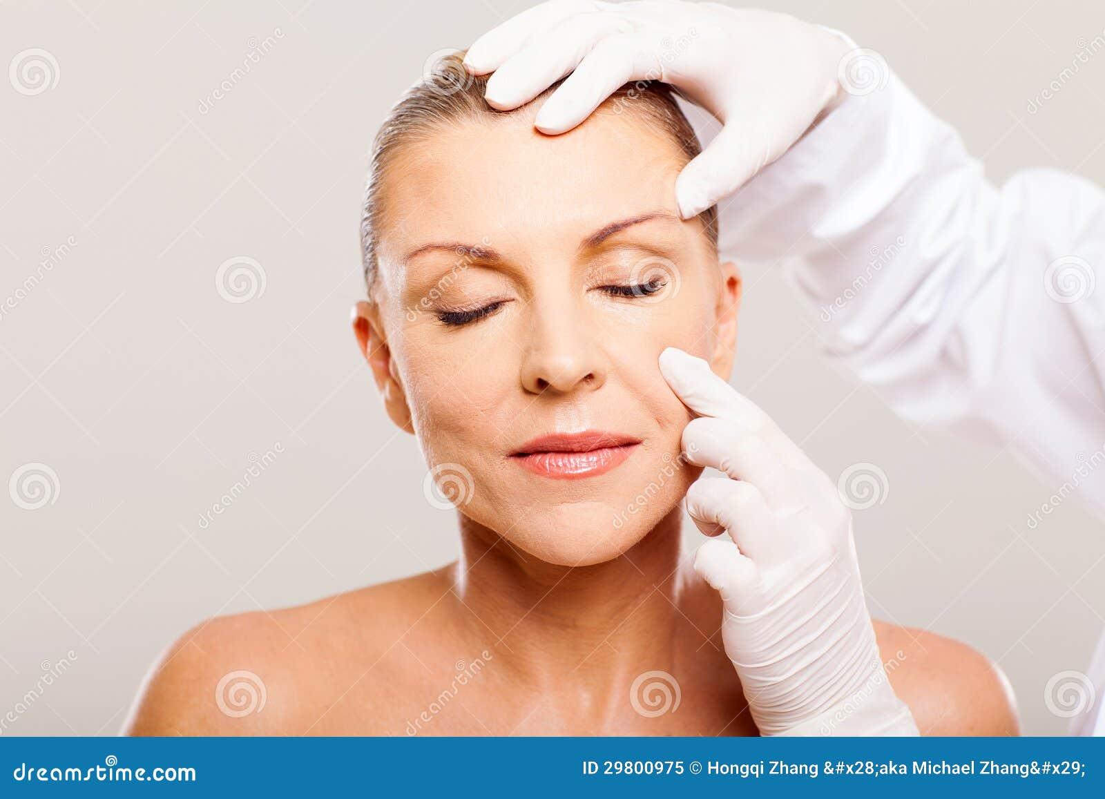 Doctor Examining Skin Royalty Free Stock Photo