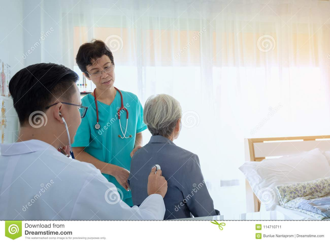 Doctor is examining Senior patient using a stethoscope