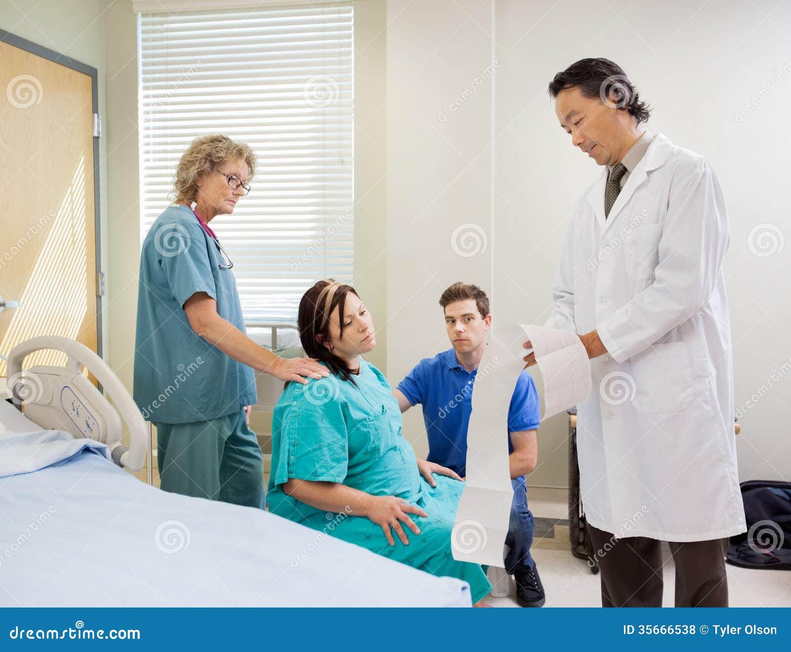 Doctor Explaining Fetal Monitor Report To Pregnant