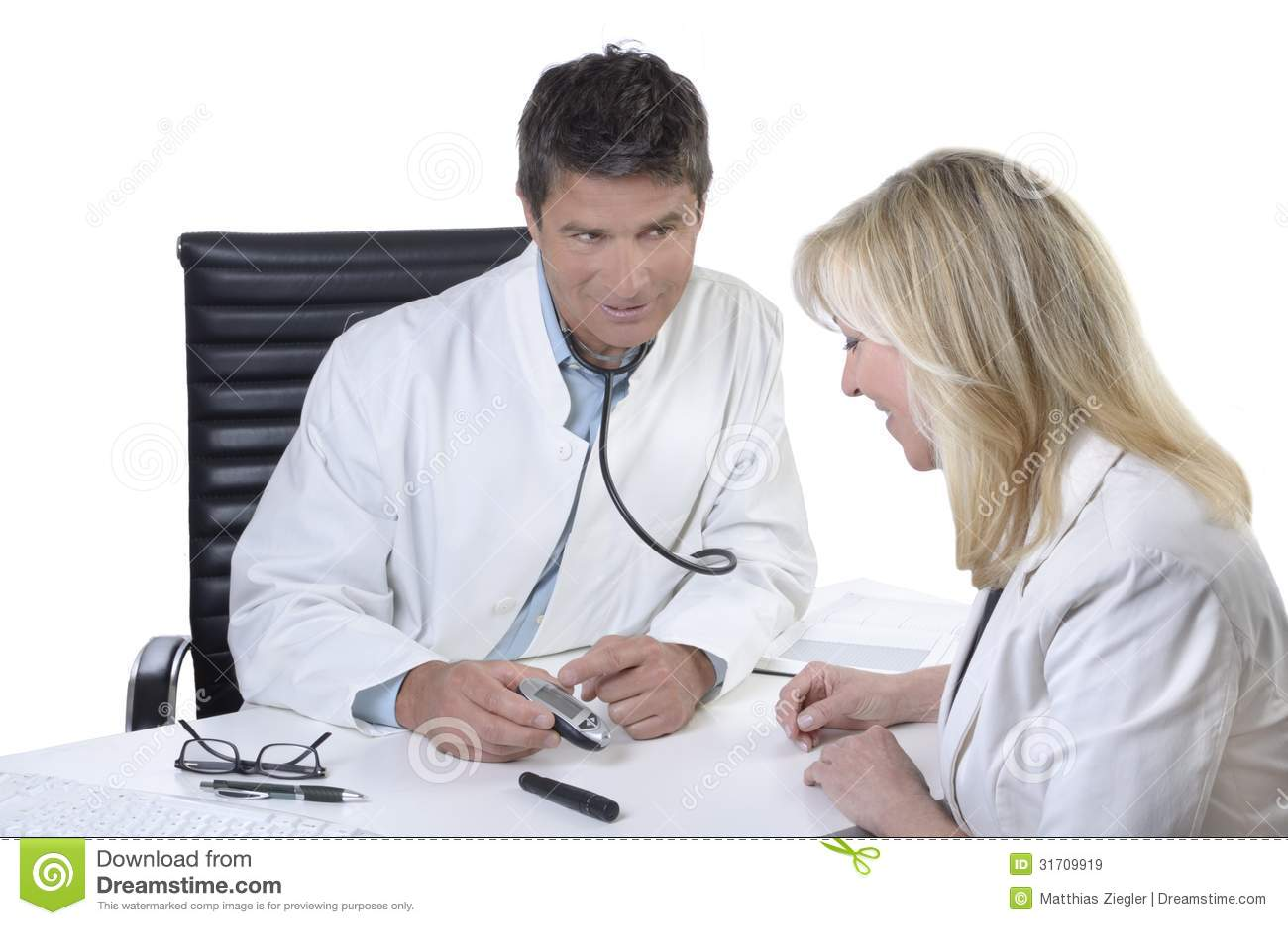 Doctor explaining function of blood sugar meter