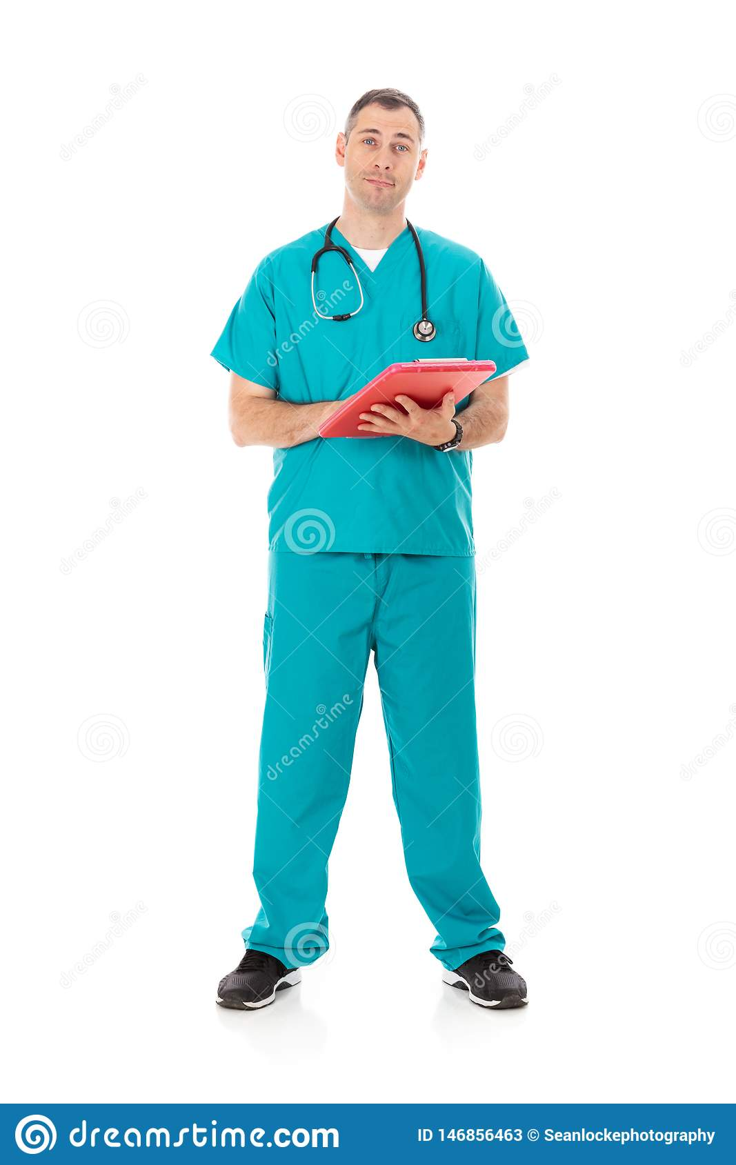 Doctor: Friendly Physician Looking At Paperwork On Clipboard