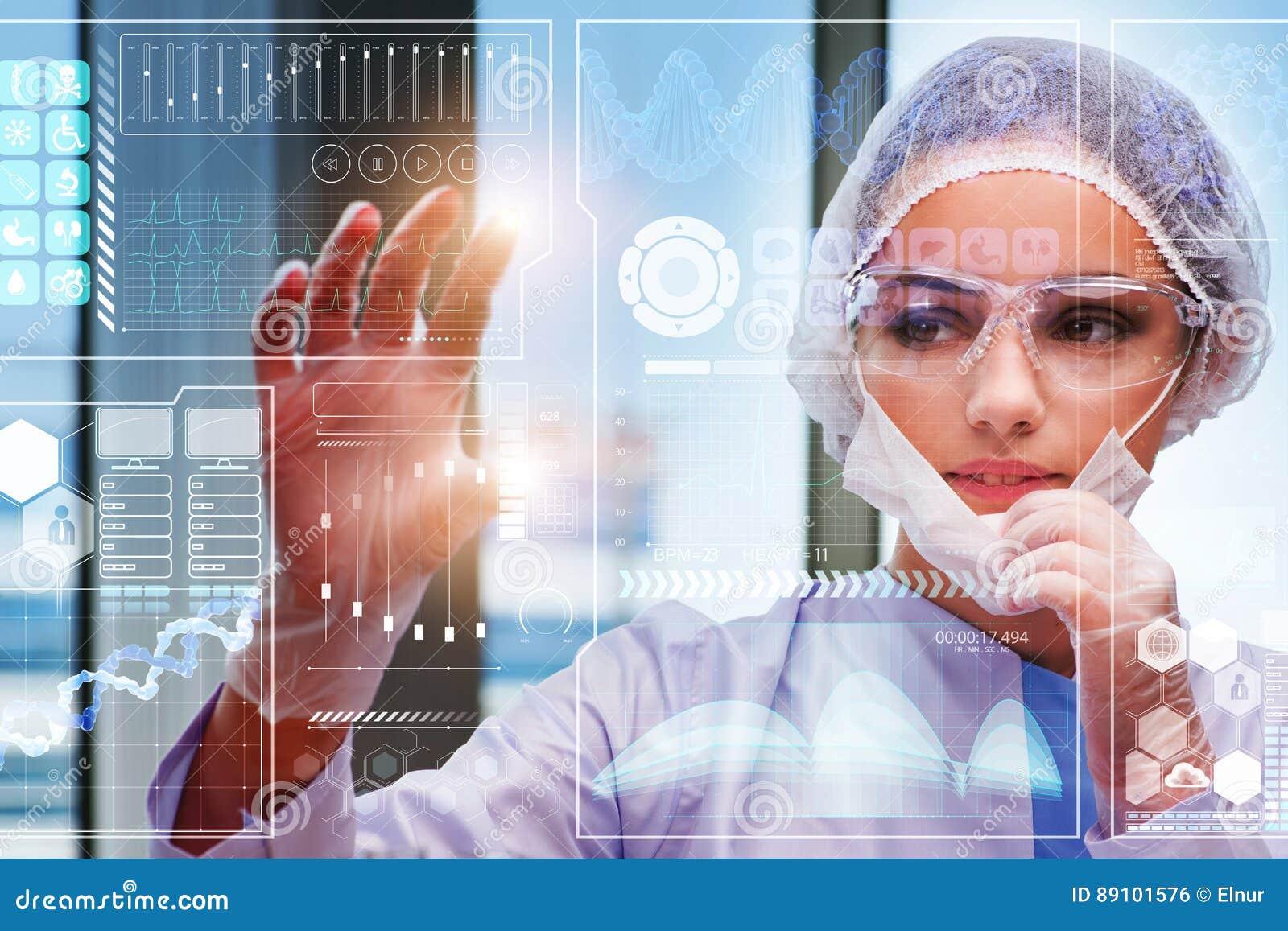 The doctor in futuristic medical concept pressing button