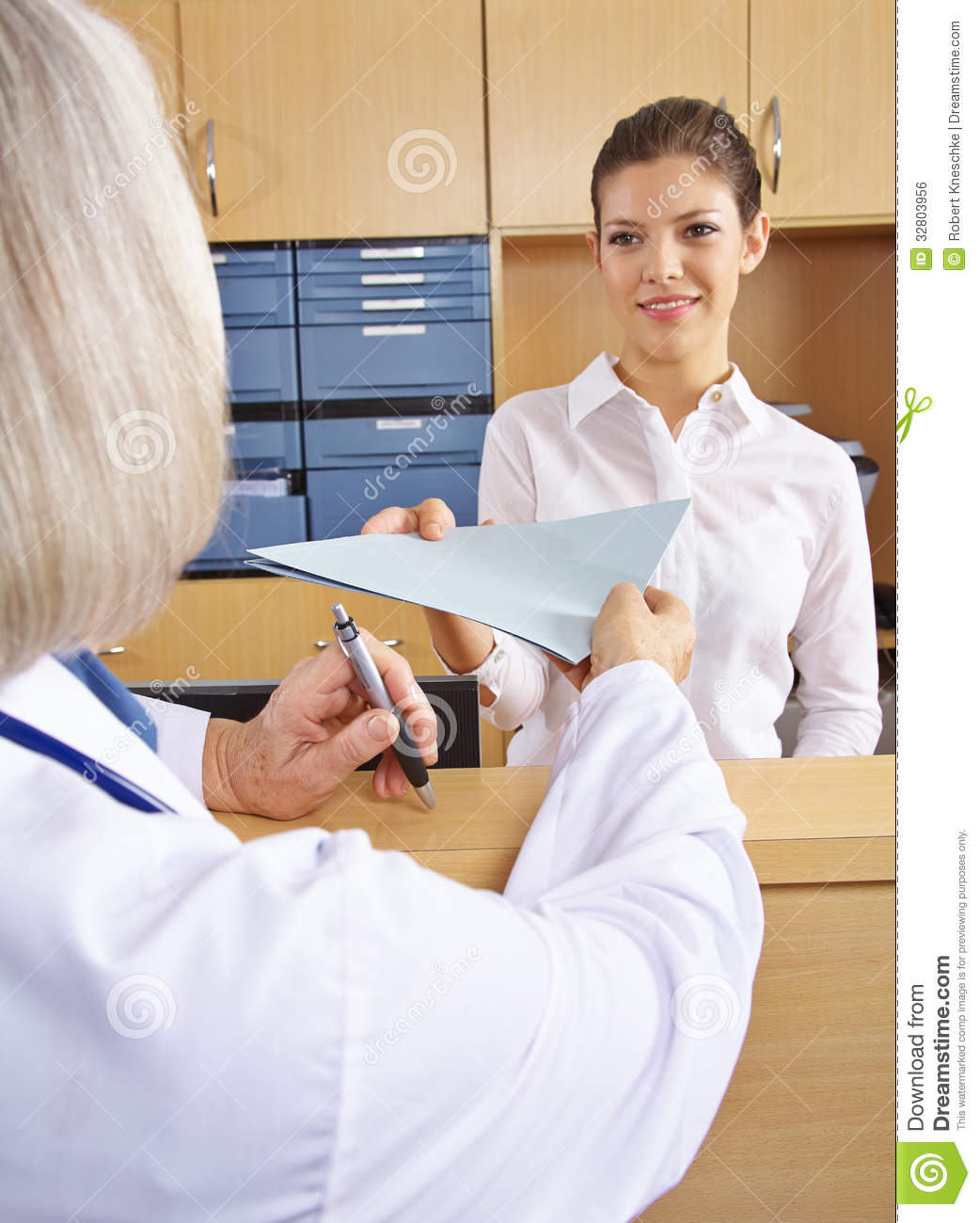 Doctor Getting Medical Records In Hospital Stock Photo