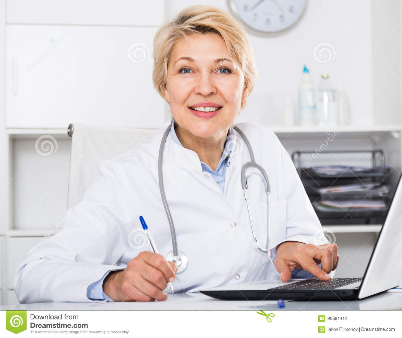 Doctor In Gown Waiting For Patient Stock Photo - Image of american ...