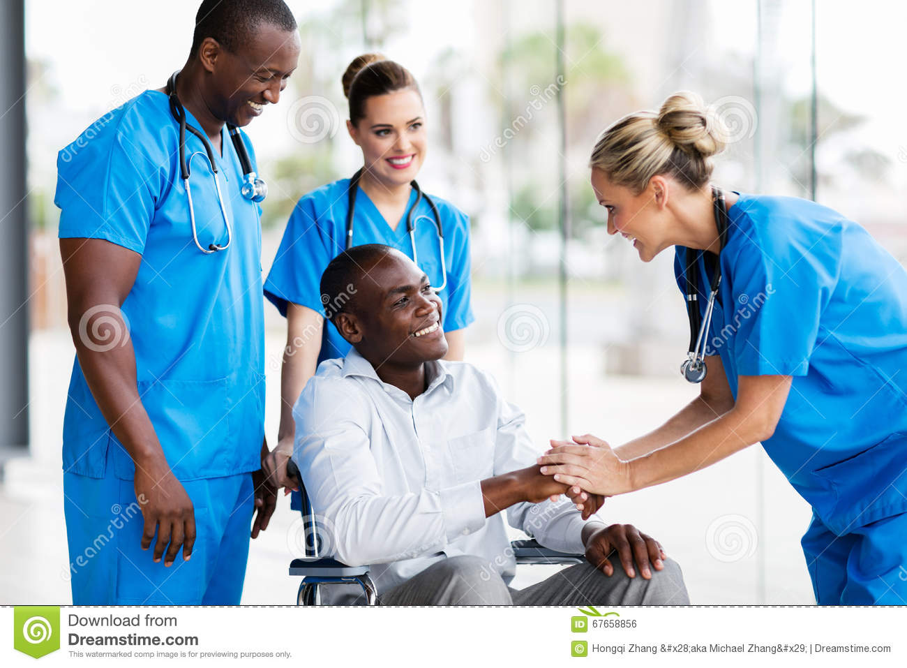 Doctor greeting disabled patient
