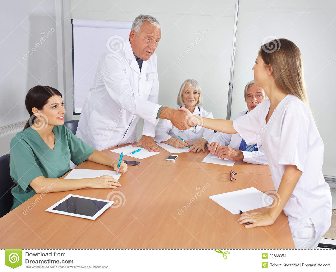 Doctor greeting new colleague in team