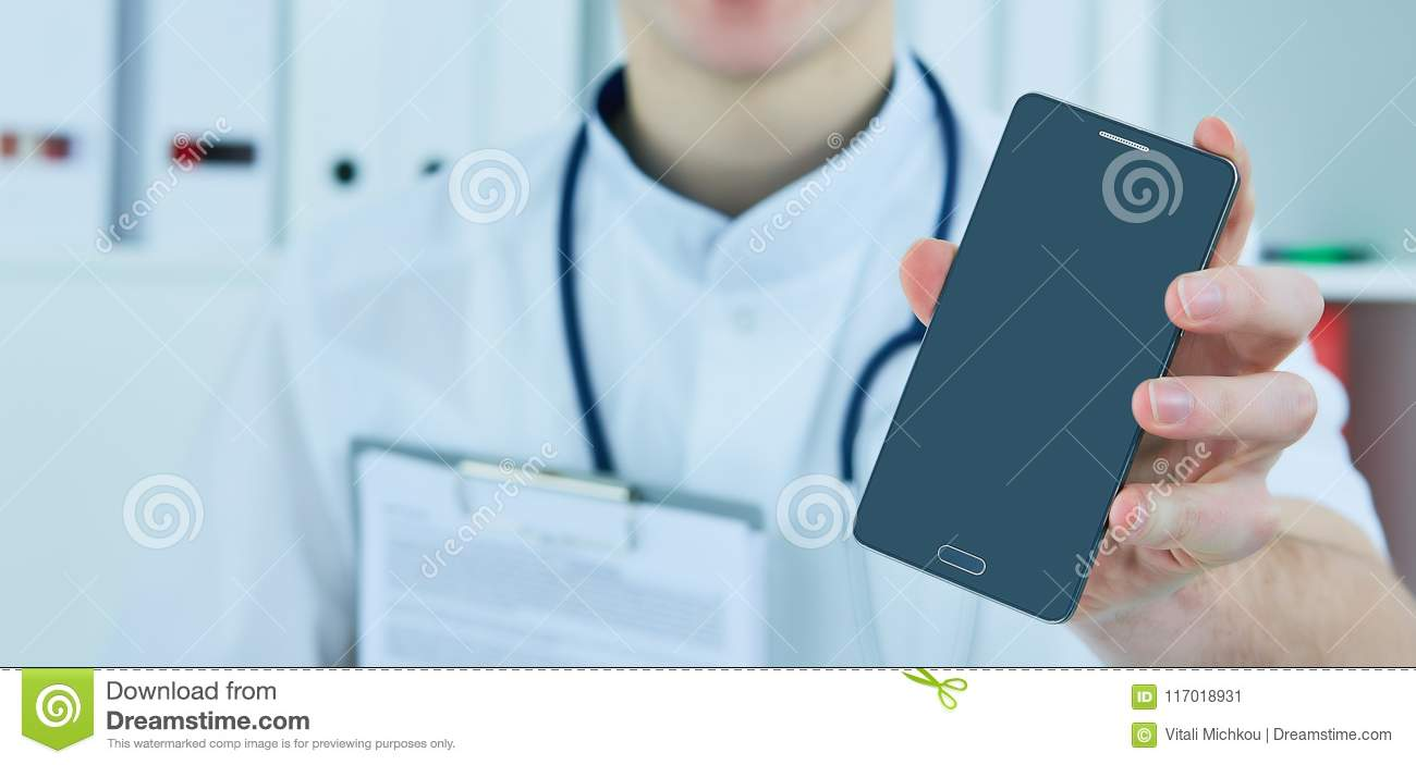 Male doctor`s hand showing a blank smart phone screen.