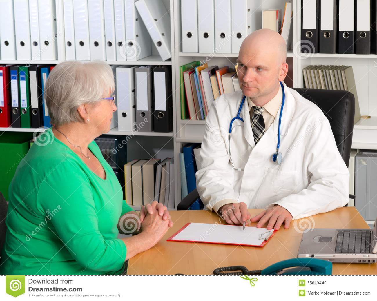 doctor in interview a a female senior stock photo image doctor in interview a a female senior