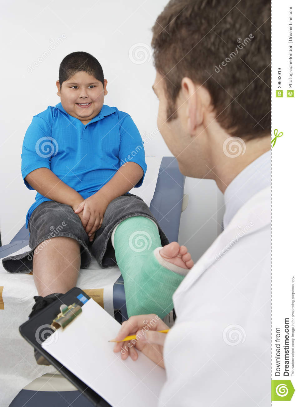 doctor interviewing boy patient royalty stock images image doctor interviewing boy patient
