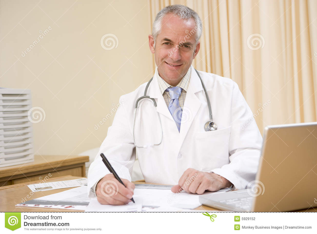 Doctor With Laptop Writing In Doctor's Office Stock Photography ...