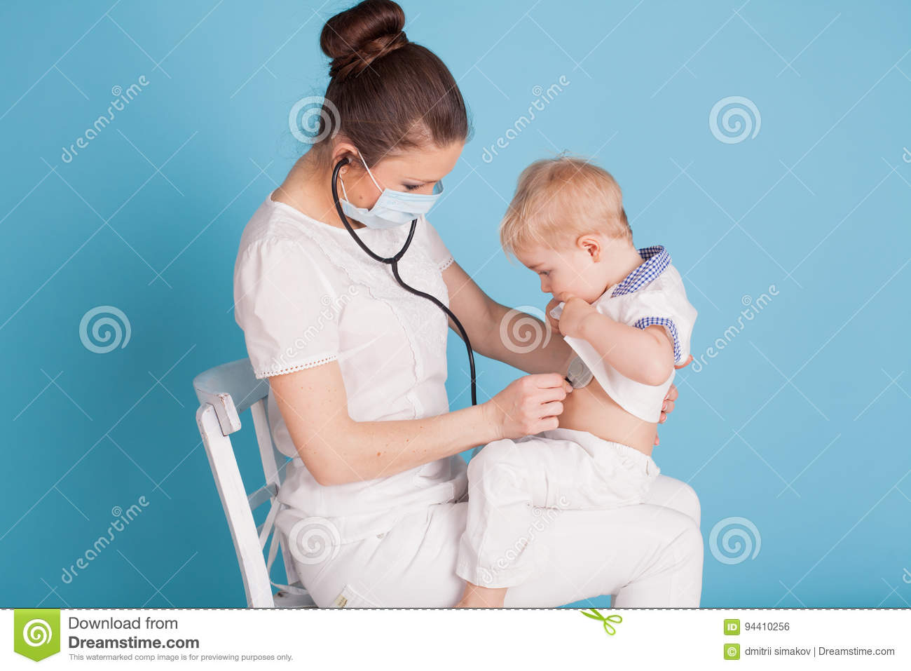 The Doctor Listens To The Little Boy Stethoscope Stock