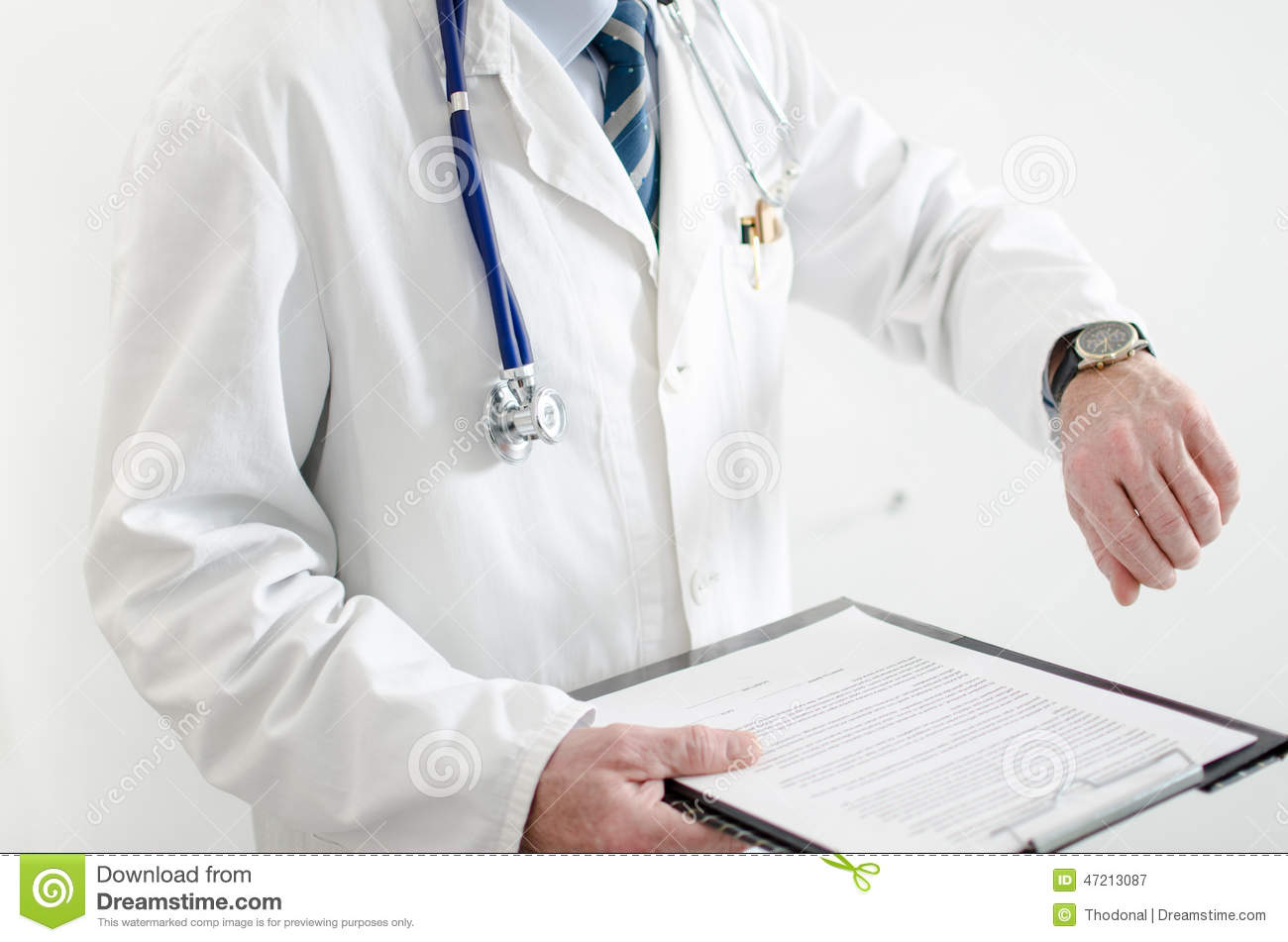 Doctor looking at his watch