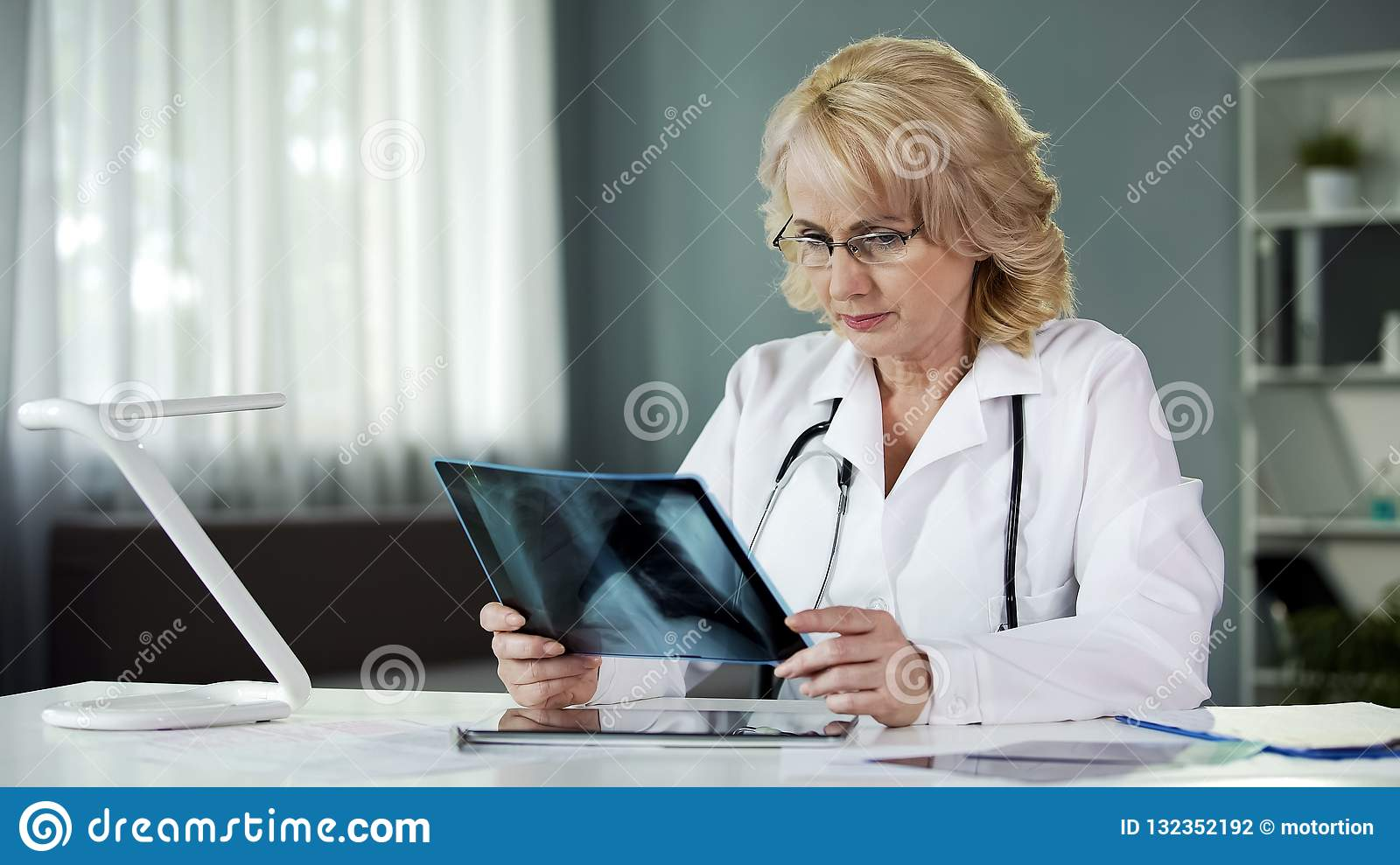 Doctor looking at scan, examining X-ray of patient lungs, health care, medicine