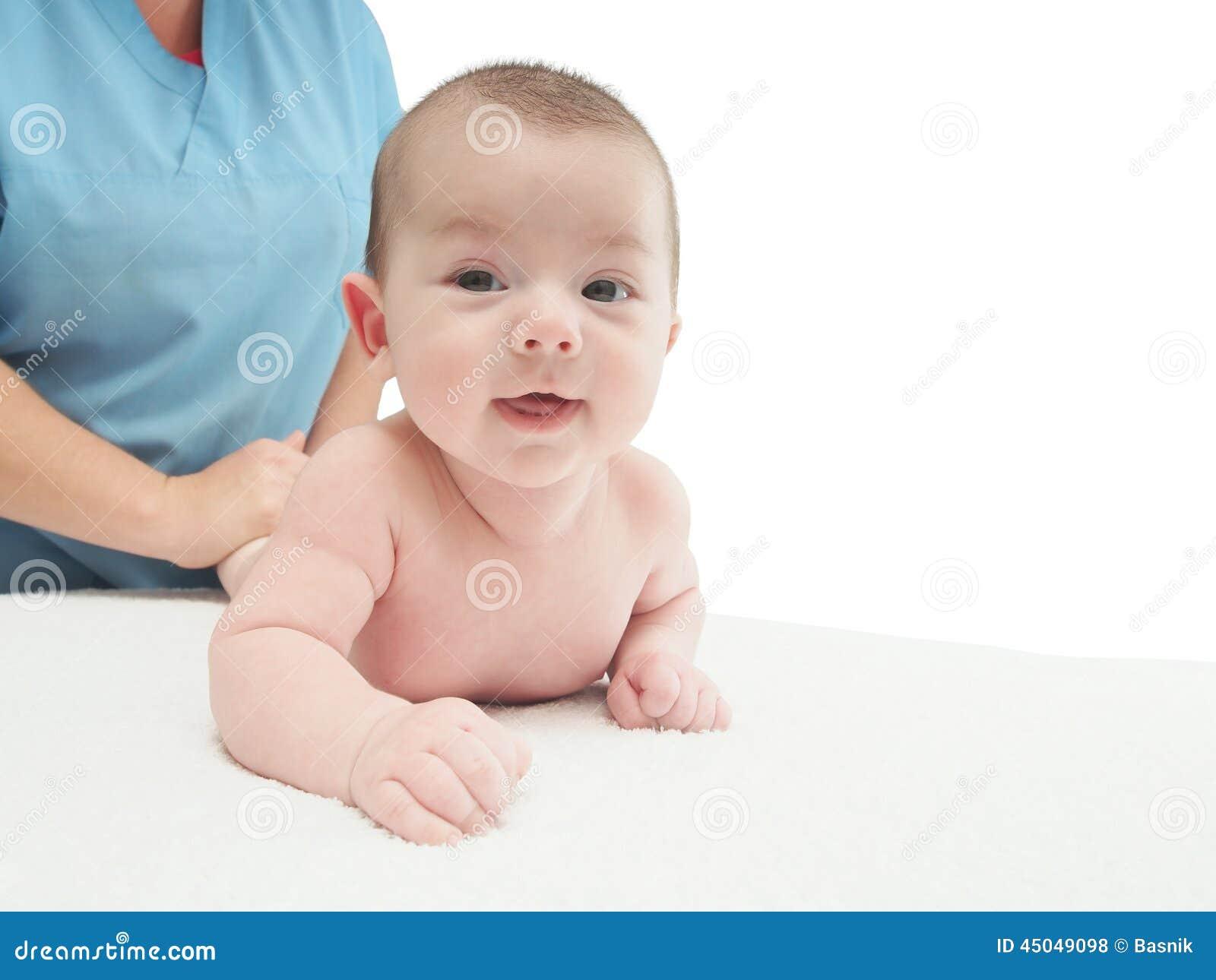 Doctor massage small caucasian baby