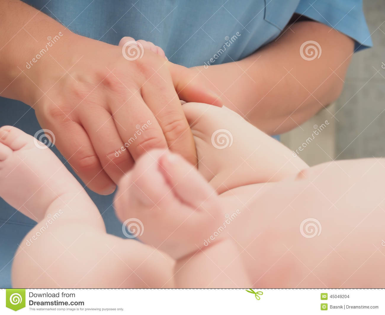 Doctor massage small caucasian baby