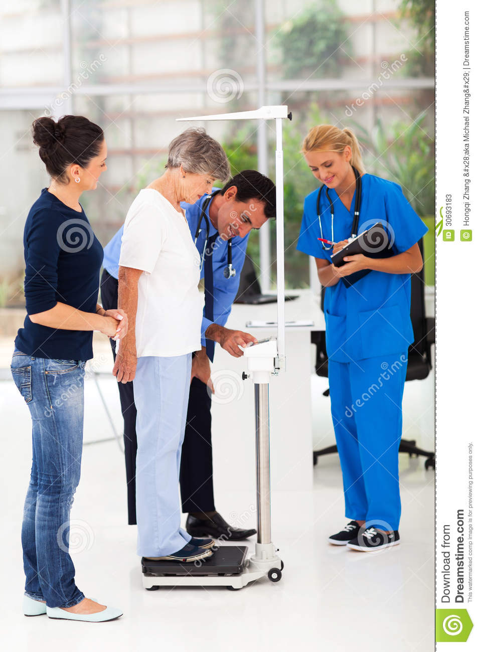 doctor measuring height weight stock image