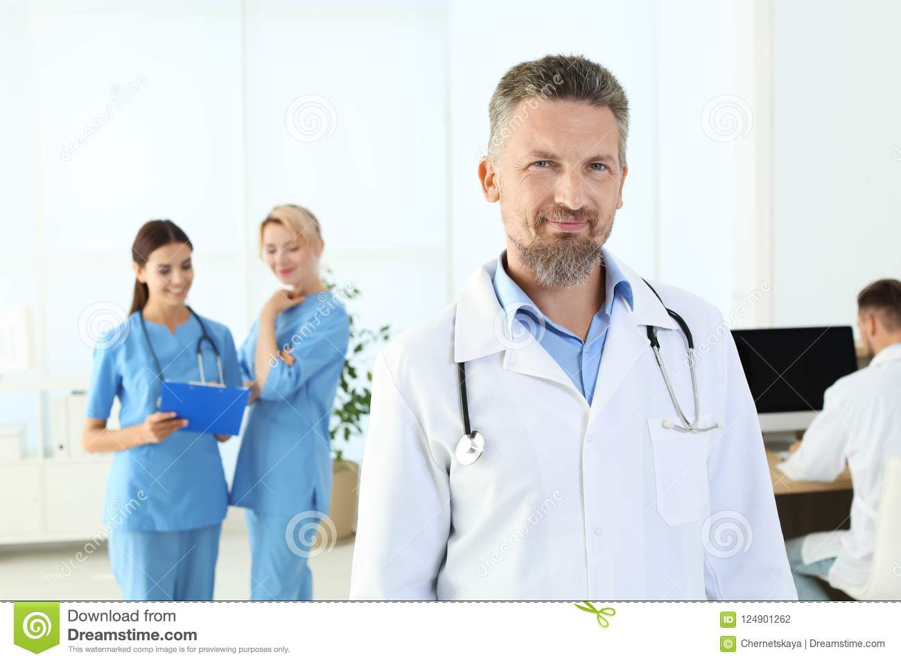 Doctor and medical assistants in clinic