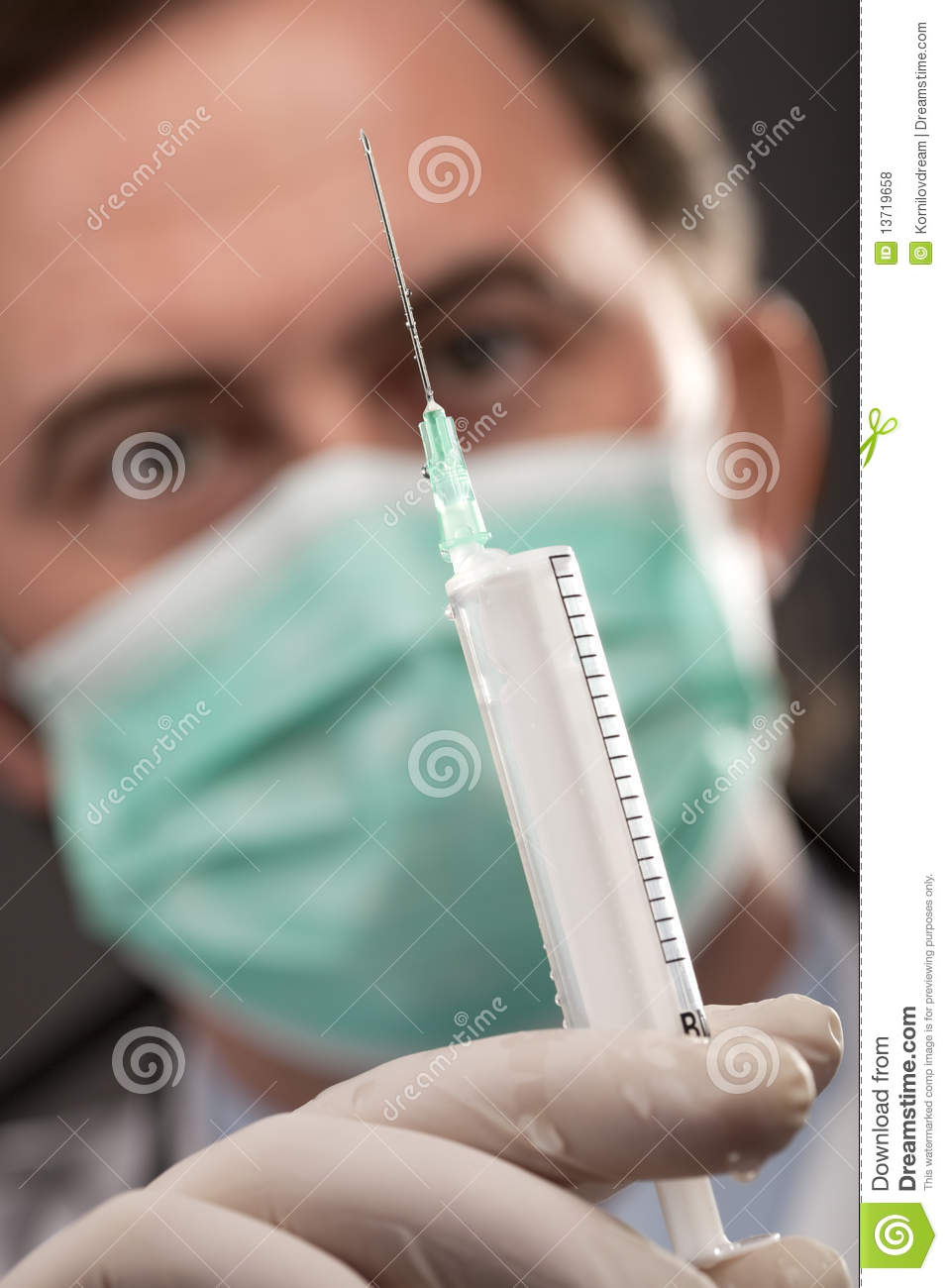 Doctor with medical syringe in hands