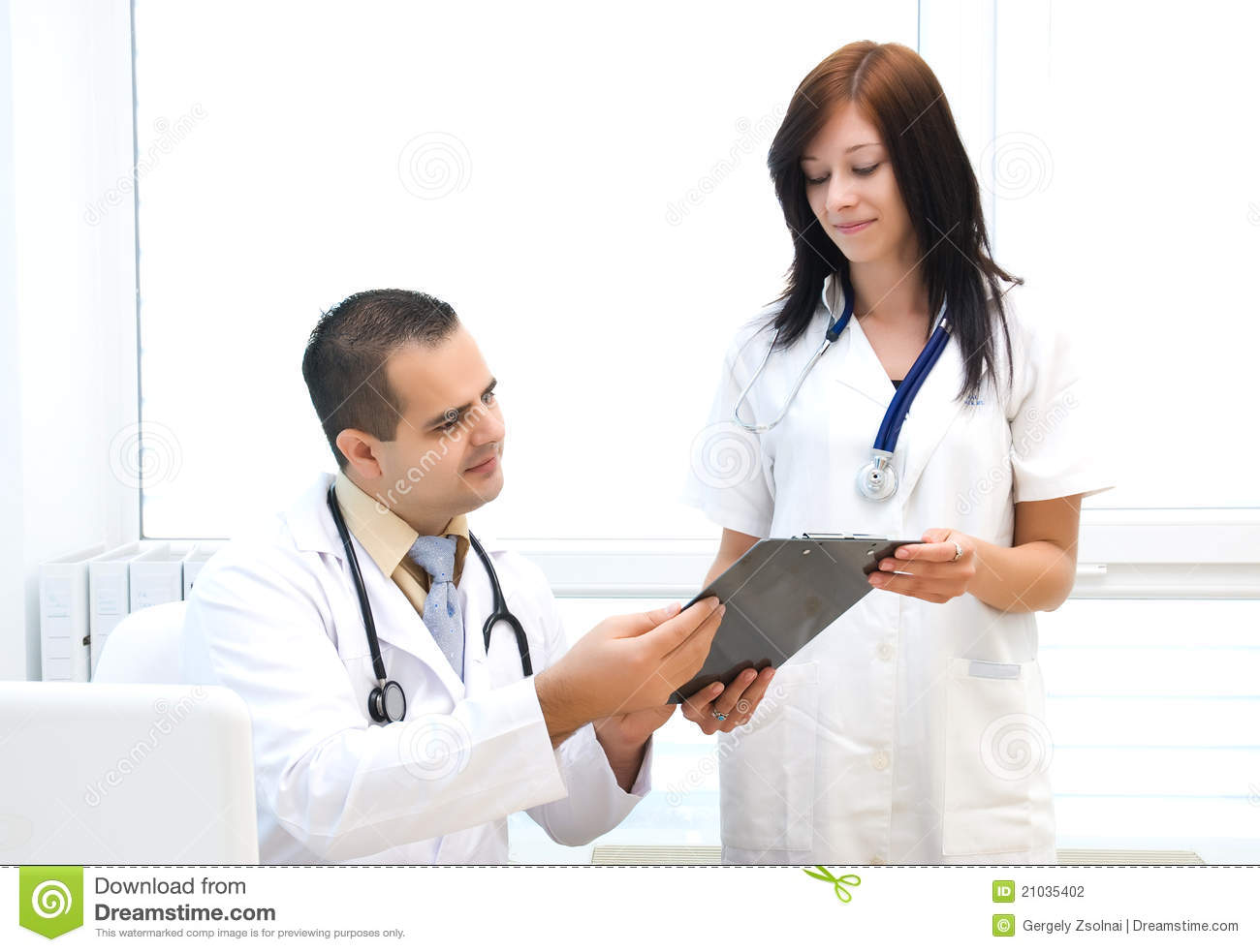 Doctor And Nurse Talking Stock Photography - Image: 21035402