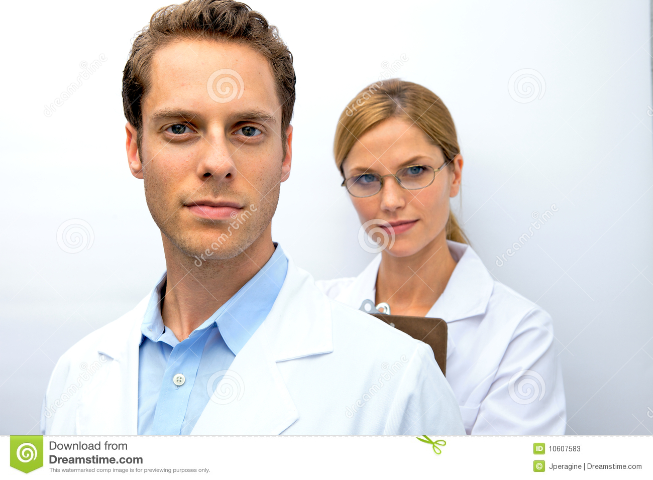 Doctor and nurse team uo on their patient