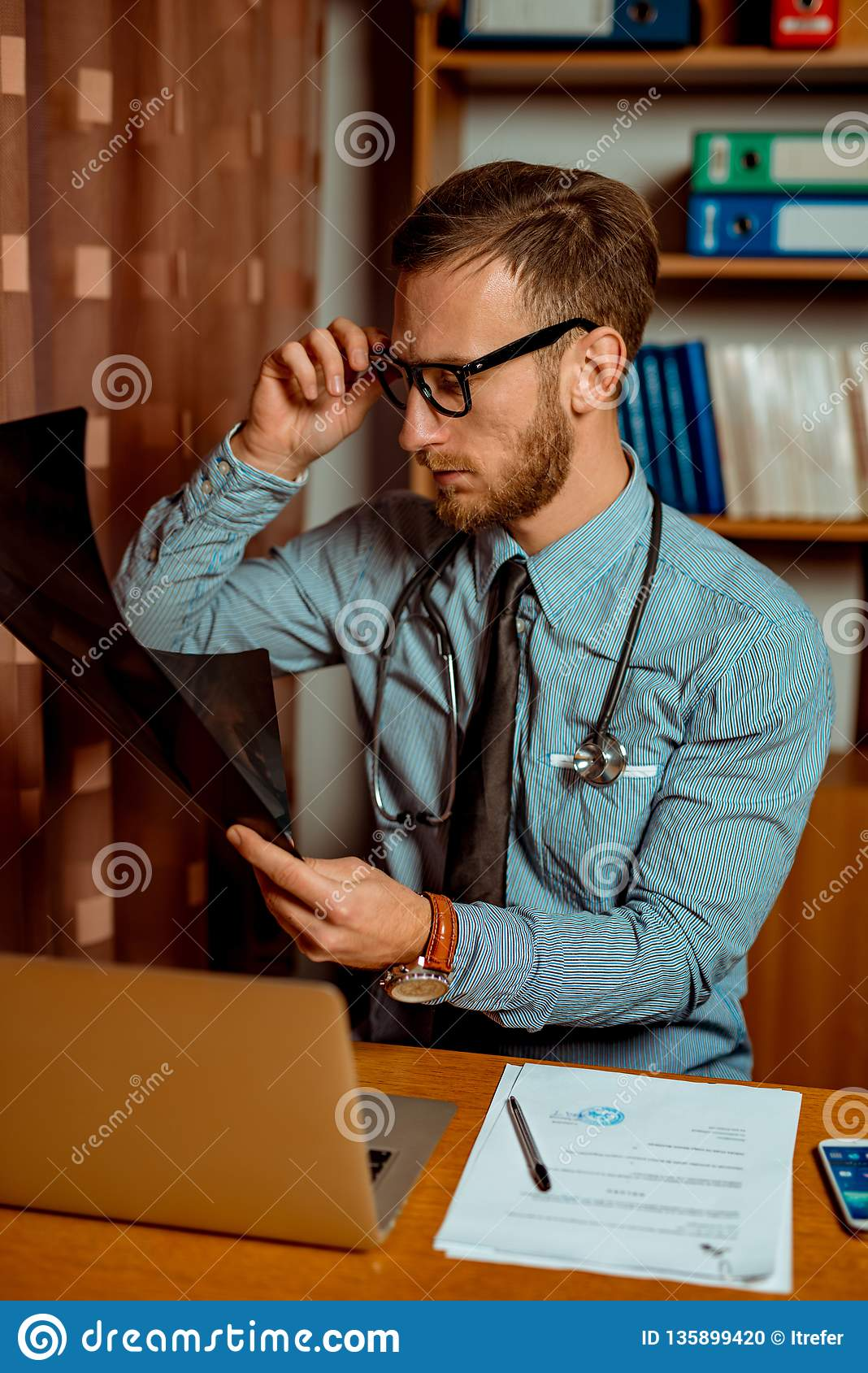 Doctor Observing X-Ray