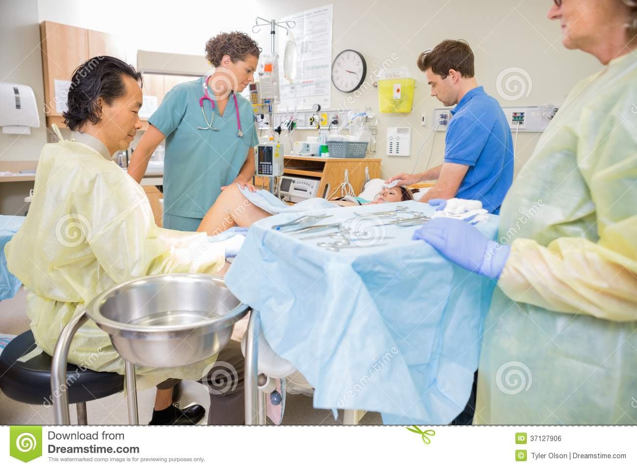 Doctor Operating Pregnant Woman During Delivery Stock Photo - Image