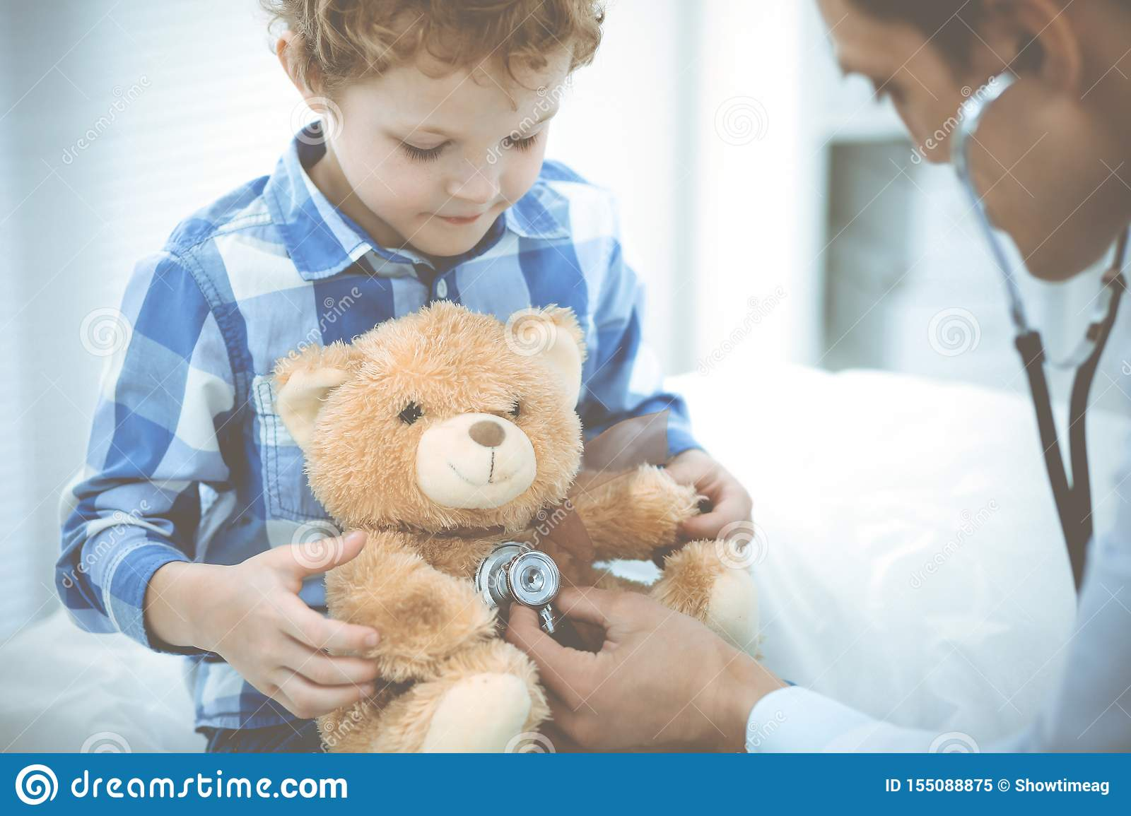 Doctor and patient child. Physician examining little boy. Regular medical visit in clinic. Medicine and health care