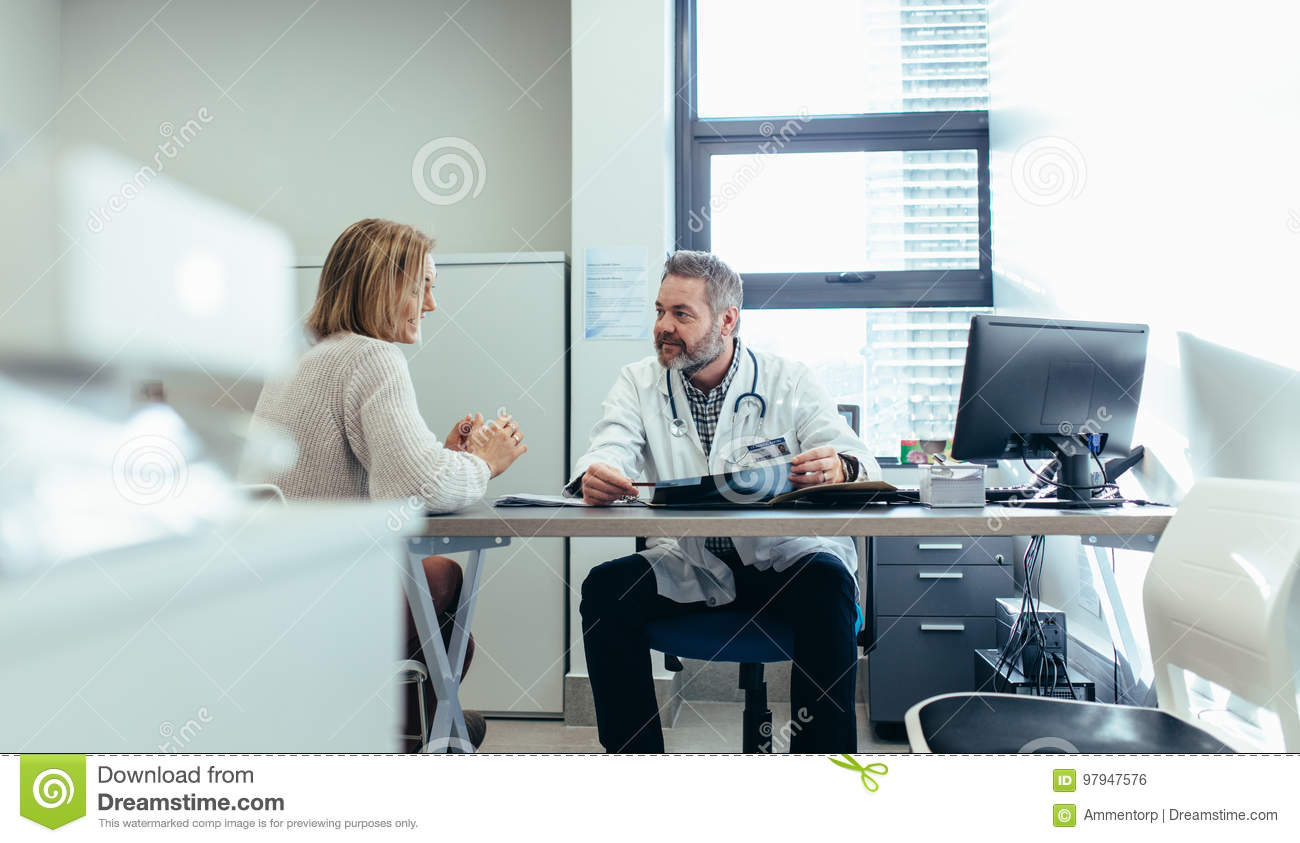 Doctor With Patient During Consultation In Medical Office Stock Photo Image Of People Practitioner 97947576